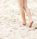 Female legs on a beach background Stock Photo