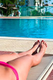 Female legs on beach bed Royalty Free Stock Photos