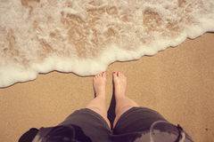Female legs on beach. top view. summerfeeling Royalty Free Stock Photos