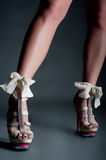 Female legs with beautiful high heels Royalty Free Stock Images