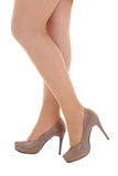 Female legs in beige shoes Stock Photos