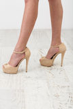 Female legs in the beige shoes Royalty Free Stock Images