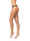 Female legs in black bikini panties Royalty Free Stock Photos