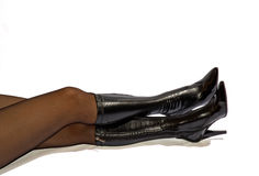 Female legs in black boots Stock Photo