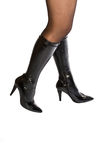Female legs in black boots Royalty Free Stock Photo