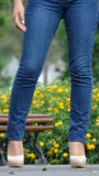 Female Legs Blue Jeans And High Heels Royalty Free Stock Image