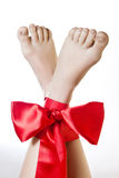 Female legs with bows Royalty Free Stock Photos