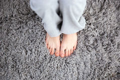 Female legs on the carpet Royalty Free Stock Photography