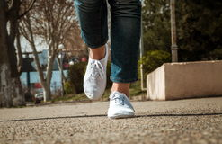 Female legs closeup with casual shoes Royalty Free Stock Images