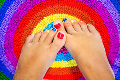 Female legs with a color pedicure Royalty Free Stock Photos
