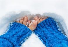 Female legs in snow Stock Photos