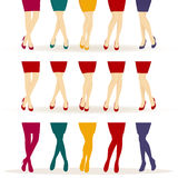 Female legs with colorful shoes Stock Photos