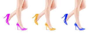 Female legs in colorful shoes. Three beautiful female legs in colorful shoes Stock Photography