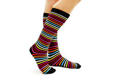 Female legs in colorful striped socks. Isolated on white background Stock Photography
