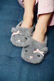 Female legs in cute slippers Royalty Free Stock Photo
