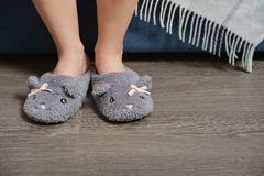 Female legs in cute slippers Royalty Free Stock Photography