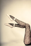 Female legs dancer in ballet shoes Stock Images