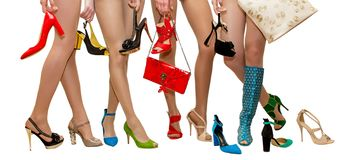 Female legs in different shoes for advertising salon shoes in the fashion magazine on a white background stock photography