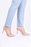 Female legs in pants and shoes in studio on a white background Royalty Free Stock Images