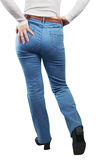 Female Legs Dressed In  Jeans. View From The Back Stock Photo