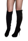 Female legs in fall boots. Slender female legs in boots isolated on white Royalty Free Stock Image