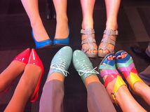 Female legs in fashion shoes. Colorful fashion shoes on feet. Stock Images
