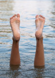 Female legs and feet upside down in the water Royalty Free Stock Photography