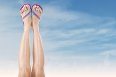 Female legs with flip-flops 2 Stock Photos