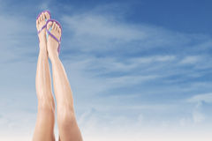 Female legs with flip-flops 3 Stock Photography