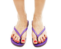 Female legs with flip-flops Stock Photos