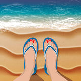 Female legs in flip flops on sand beach and sea Royalty Free Stock Image