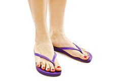 Female legs with flip-flops Stock Photo