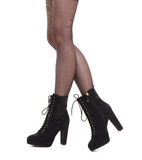 Female legs foots in fashionable black shoes boots Royalty Free Stock Photos