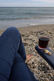 Female legs and glass of wine on the empty beach. Vacation selfie- female legs and glass of wine on the empty beach stock images