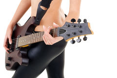 Female legs and guitar isolated on a white backgr, Royalty Free Stock Photography