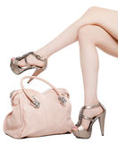 Female legs and handbag Royalty Free Stock Image