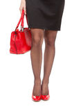 Female legs and a handbag. Isolate on white. Stock Photography