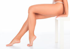 Female legs and hands Stock Photos