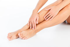 Female legs and hands Stock Photography