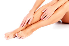 Female legs and hands Stock Image