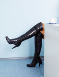 Female legs in high black leather boots. Young woman's legs in high black leather boots Stock Images