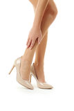 Female legs in high-heeled shoes Royalty Free Stock Images