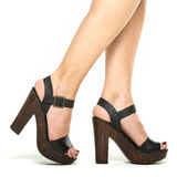 Female legs in High Heels Shoes with wooden platform sole Stock Photo