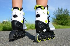 Female legs in inline skates. Stock Image