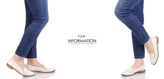 Female legs in jeans classic lacquer white shoes moccasins spring autumn fashion buy shop set pattern royalty free stock images