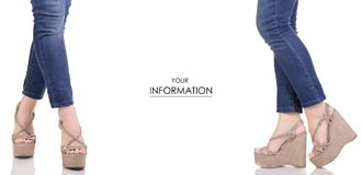 Female legs in jeans and gray sandals on a wedge buy shop fashion beauty set pattern Royalty Free Stock Image