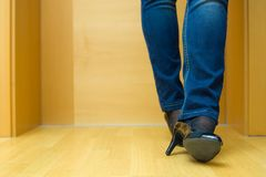 Female legs in jeans and  high heel shoes waiting Royalty Free Stock Image