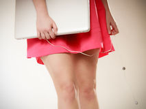 Female legs and laptop with headphones Royalty Free Stock Photos