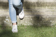 Female legs leaning on a wall Stock Photography