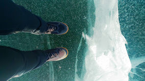 Female legs in leather boots standing on cracked ice, top view Royalty Free Stock Photos